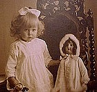 Cute YOUNG GIRL WITH DOLL PHOTO POSTCARD c1910