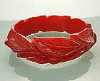 Cherry Red Deeply Carved Leaf Form Bakelite Bangle