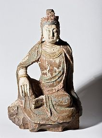 A Chinese wood carving of a seated Guanyin