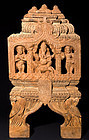 Indian wooden temple carving with Ganesh and Shiva