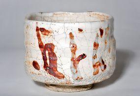 Momoyama/early Edo Period Shino Chawan with organge fire colour