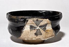 Mid Edo Period Kuro Oribe Chawan with ink black glaze