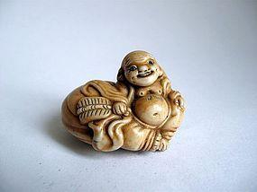 Japanese Hirado Porcelain Netsuke of Hotei, Signed