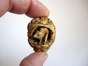 Japanese Antler Netsuke of Fox Emerging from A Demon