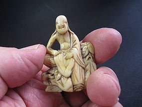 Japanese Ivory Netsuke of a Seated Sennin