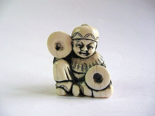 Japanese Marine Ivory Netsuke of a Child with Cymbals; Signed