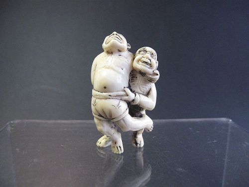 Japanese Ivory Netsuke of a Man Wrestling an Oni, SIgned