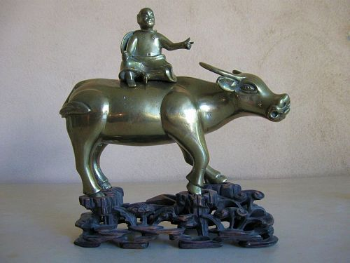 Chinese Polished Bronze Buffalo and Rider Censer, with Stand