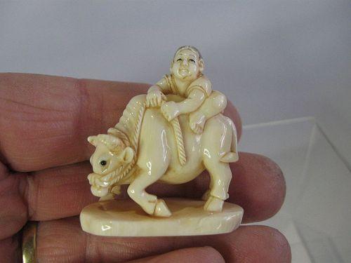 Japanese Netsuke of a Boy Riding a Buffalo