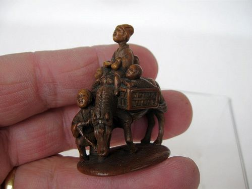 Japanese Stained Netsuke of a Peasant Leading a Horse by Tomochika