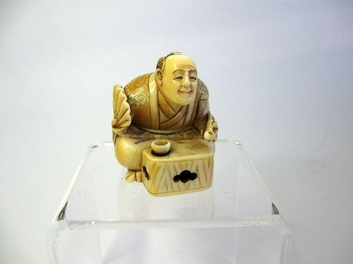 Japanese Carved Netsuke of a Man Seated at a Table, Signed