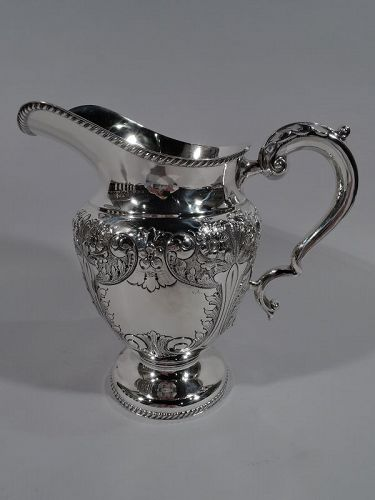 Fancy and Flowery Old-Fashioned Sterling Silver Water Pitcher