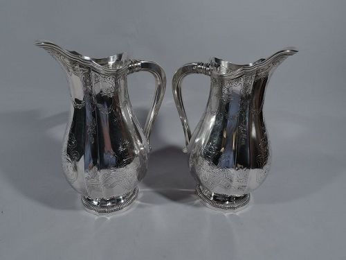 Pair of French Belle Epoque Classical Silver Water Pitchers