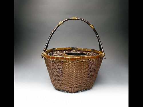 antique Japanese bamboo basket ikebana flower arrangement