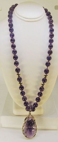 Carved Amethyst and 14Kt Gold Pendant on an Amethyst Necklace