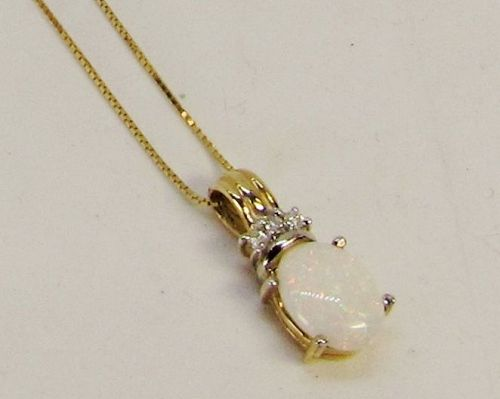 Opal and Diamond Pendant with 18� Chain 14Kt Yellow Gold