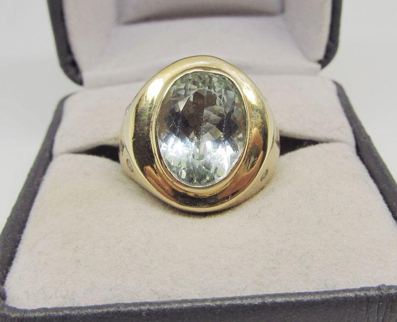 14Kt Gold Aquamarine and Etoile Set Diamond Ring