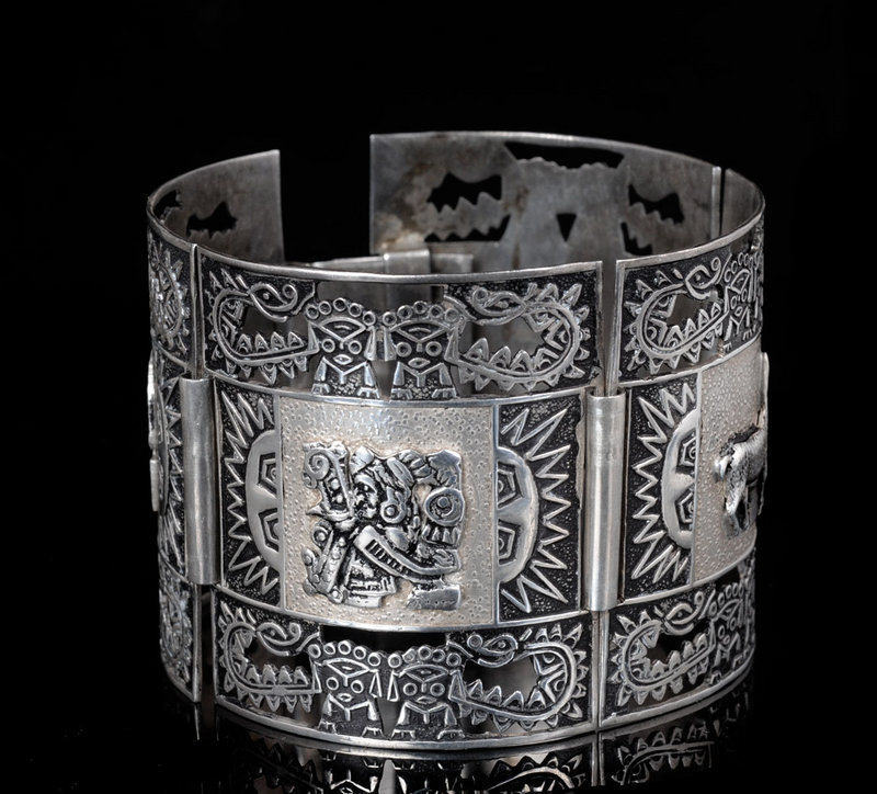 WIDE PERUVIAN SILVER BRACELET with Figural APPLIQUES