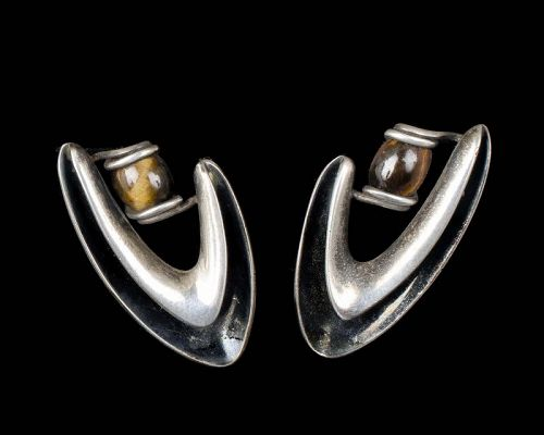 iconic Sigi Pineda Mexican silver boomerang Earrings with tiger's eye