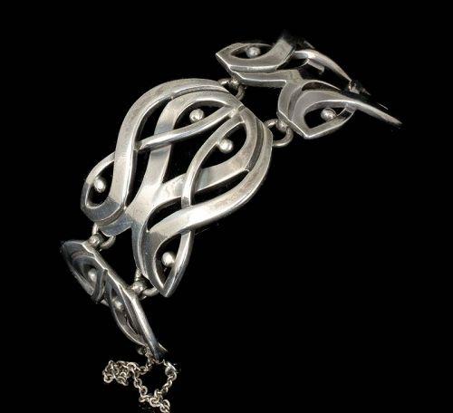 """Jose Luis Flores Mexican silver """"double masks"""" modernist Bracelet"""