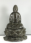 A large Japanese Bronze seated Buddha, 19th century.