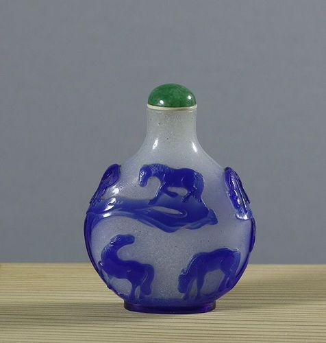A Fine Chinese Carved Blue Overlay Glass Snuff Bottle, 1800~1850.