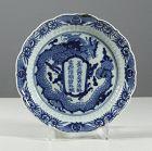 Arita Dragon and Calligraphy dish, circa 1780. Filled chip.