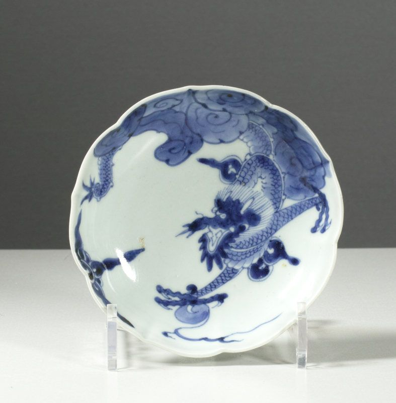 A Japanese Arita lobed dish decorated with a dragon descending. #3