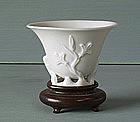 A Blanc de Chine Magnolia Wine Cup, circa 1650.