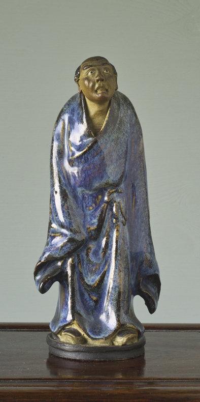 Chinese Shiwan Stoneware Monk, circa 1900.