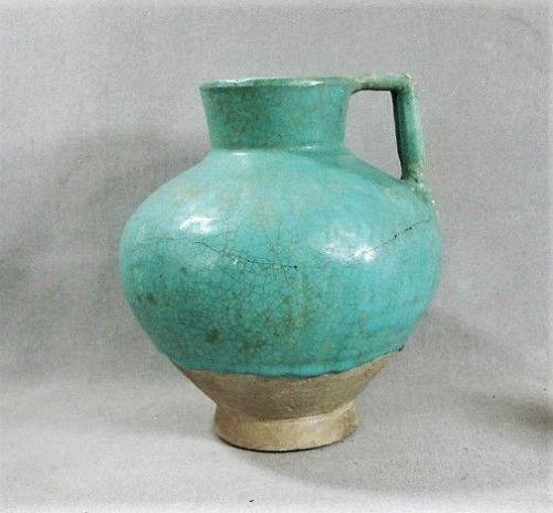 Kashan Handled Jug in Turquoise Glaze - Seljuk Era - 12th Century
