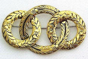 Golden Metal Eternity Brooch