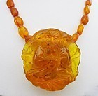 Stunning Copal Bead and Carved Buddha Necklace