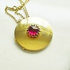 Round Gold Toned Locket with Large Ruby Red Rhinestone