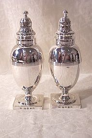 A Pair of Georgian Sterling Silver Pepper Pots