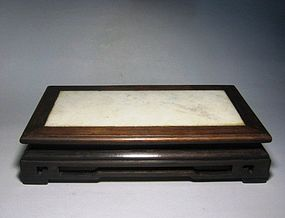 An Old Wood Stand with Marble Surface