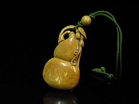 An Ivory Pendent in Double Gourd Form