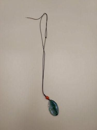 A Beautiful Jadeite Pendant in Fish Form.