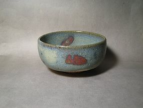 A Purple-Splashed Jun Bowl in Rustic Form
