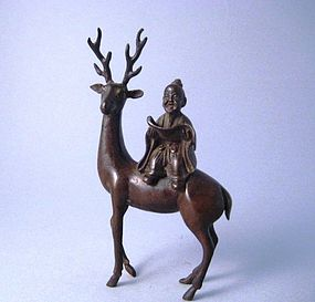 A Fine Bronze Piece of a Sage Riding on a Deer