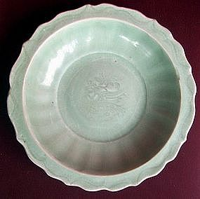 A Ming Celadon Dish with Bird motive