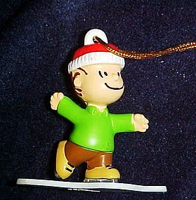 Peanut character Linus ice skating ornament pvc