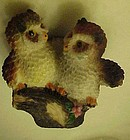Two owls on a branch resin figurine