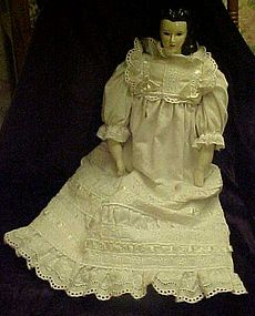Pretty hand made china doll with petticoat and dress