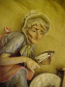 Welsh figurine old woman with knife at grinding wheel