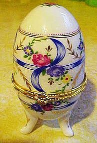 Pretty porcelain egg trinket box with ribbons and roses