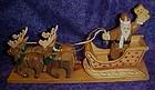Carved wood Santa sleigh and reindeer decoration