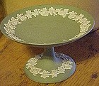 Green Wedgewood Jasperware compote with grapes