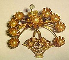 Goldtone basket and flower pin with pearls