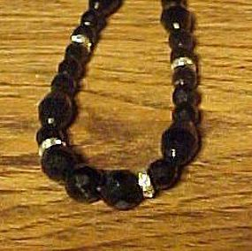 Vintage black glass faceted bead necklace with rondells